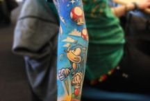 Video Game Tattoos / Amazing Video Game Based Tattoos  / by TheGameJar