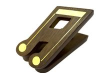 Timber-Treasures double note music clip / A beautiful and unusual hand made music clip, crafted from Indian rosewood and inlaid with brass detailing. This music clip is styled as a double note and would be the perfect and useful gift for any musician.  Each of our music clips is sprung to work just like a standard peg, with the mechanism crafted from sturdy metal parts including the finest brass. Dimensions: 9 x 4 x 7 cm* *handmade disclaimer