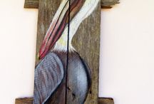 PELICAN ON FENCE