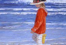 bambino.con giaketta rossa e.Capello in riva aqua