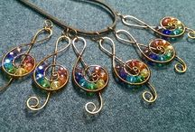 Musical note pendant with stones rainbow colors.