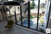 Reportage photo piscine avec terrasse en pierre naturelle / Découvrez notre reportage photo sur une piscine se situant dans la région Rhône-Alpes.