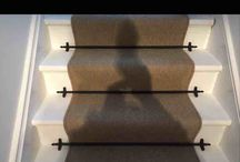 Pictures of a stair  runner with rods and eyes