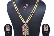 Stylish and Stunningly beautiful Pearl Set in Golden Colour Pearls at Rs. 5,950