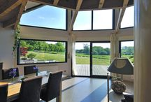 Maison contemporaine bois demi-polygonale