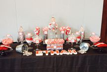 Minecraft theme Red, white and silver candy buffet / This candy bar was designed for a young boy's Bar Mitzvah. He is a Minecraft fan so we used the Minecraft font to do the tags and named the candies after Minecraft objects