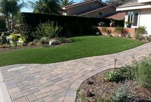 """Residential Artificial Grass /  Our Motto, """"Save Water, Save Time, Save Money, Always Manicured & Always Green"""" speaks for itself. Our Turf Installations can last up to 25 years with a Return on Investment at approximately 2-3 years. After you break even, you're saving a couple thousand dollars every year on Water & Maintenance. No brown patches, No Mowing & Edging, No Watering, No Pests, No Reseeding & No Weeding. Simply, more free time enjoying Life & enjoying your beautiful landscape."""