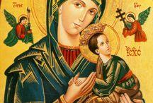Quadros de santos e santas