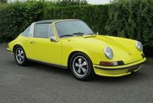 Porsche 911 / A modern classic if ever there was one, the long-running 911 arrived in 1964 as a replacement to the 356. An ideal sports car, from the beginning it was easy to drive, reasonably comfortable, and not terribly complicated. It was a work of art, styling evidently being more important to customers at first, sales of the four-cylinder 912 totalling 9,000 to the 911 six-cylinder's total sales of 4,000 in 1966.