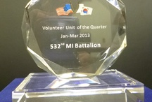 2013  BN Volunteer of the Quarter / LTC Biggerstaff of 532nd MI accepting the award for the 2013 BN Volunteer of the Quarter from COL Conkright on April 16, 2013  - The BN was recognized for over 800 of volunteer hours.