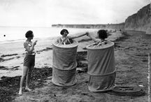 Two women changing discreetly on a beach in Skreenette bathing tents, 1929
