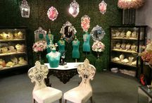 Rare heritage / Exhibition design   Concept - fresh & classy Elements - green wall                 - cherryblossoms                - orchids                 - venetian mirrors                 - vintage black displays                 - carved furniture                 - jade green busts                 - floral chandeliers