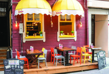 City Burger / Restaurant Design. Wooden tables, benches and colorful chairs