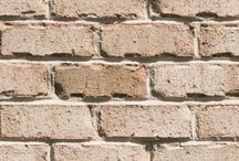 Nantucket   Triangle Brick Company / Set apart from the rest of Cape Cod, Nantucket offers an oasis of sandy beaches, historic lighthouses, and cobblestone streets just off the coast of Massachusetts. Classified under our exclusive Select product tier, Triangle Brick Company's Nantucket brick draws inspiration from the natural serenity of this New England island, offering a rich, tumbled texture, a warm, neutral sand color, and subtle orange, brown and charred gray accents.