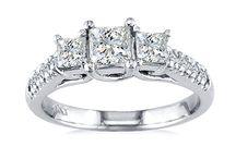 "Three-Stone Style Engagement Rings From Diamonds Rock / The three-stone style represents the ""past, present, and future"" of your relationship. It also is one of the most classic styles. Typically set it round diamonds, the side stones being slightly smaller than the center stone to show a bright, big future ahead of you"