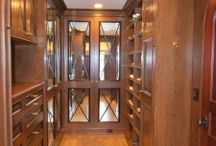 CUSTOM CLOSET PROJECTS / Custom cabinetry, lighting, vanities, flooring and window treatments for client's closet spaces.