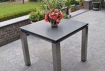 (Tuin) Tafels op maat / RVSTuintafel.com is dé specialist in het ontwerpen en maken van RVS tafelonderstellen met een op maat gemaakt tafelblad. Doordat de natuurstenen tafels oerdegelijk en van hoge kwaliteit zijn, kunt u het hele jaar genieten van uw prachtige tuinset! Hier ziet U een impressie van onze maatwerk producten.
