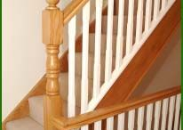 Natural Timber Handrails with White Spindle for Stairs and Landings / A straight flight leading to a quarter landing has been utilised here. Oak strings, handrail and newel posts are brightened up by the white painted softwood stop chamfered spindles.