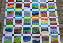 strip quilts / Quilts made with stripped fabric