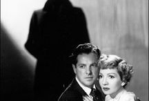 Film Noir / The dark and seductive era of cinema. Red lipped femme fatales and dangerous men, The epitome of 40's cinema.