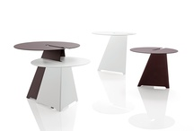 ABRA Tables / A minimalist low table in scratchproof painted steel.. Available in 2 different heights.. thanks to the geometry of their lines, dovetail perfectly. A design of Neuland Paster & Geldmacher, 2011.