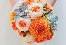 Lucy & Andrew / Oranges in various shades with grey. Calla lilies, Roses, Spray Roses and Peonies