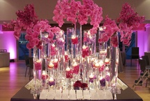 Nikki's Hot Pink Bat Mitzvah Party at the Maritime Parc New York / Nikki is a kind of a girl who likes her Bat Mitzvah's party night to be chic and fun. To make her night very special, we proposed the flower colors to be in hot pink and purple with touch of silver and a lot of candles just like what she loves with the modern floral designs. The night turned out very specially beautiful with the view of the lower Manhattan as the backdrop