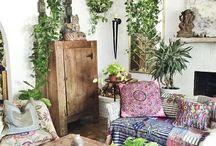 Bohimian living room wth many plants