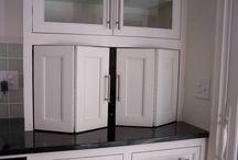 Cupboard around fridge space