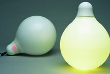 LOAD Portable lamp - Limited edition - 2002 / An opal portable lamp with round soft shapes that can be used cordless anywhere, just as your mobile phone. Load is made of rotation moulded polyeten that feels nice and soft in your hands. Due to the combination of material and shape Load is also almost completely shook proof. The rechargeable battery can provide 5 hours of light.  Year Completed: 2002 Creative Director: Monica Förster
