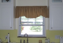 Valances / Valance treatments, window treatments above the window, usually added to complement the design and decor of the room. We do quite a few valances, toppers, and cornices and use them in combination with other window treatments.