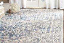 Area rugs on wood floor