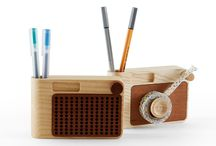 BUZZ & CLICK - DESK ACCESSORIES / Buzz &Click are two wooden accessories for your desk. The designer took familiar objects we tend not to use much anymore, like a radio and a film camera, and translated them into a tape holder and a pen&cards holder.