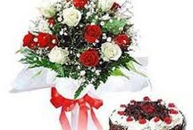 Roses / Dozen Red Roses in a glass vase with greenery