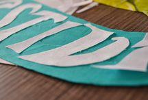 Design Gráfico / Nosso papel aqui é criar uma expressão única para seu projeto. Trabalhamos com as cores, tipografias, dobraduras, recorte, colagens, uma diversidade de materiais que dão forma ao seu projeto. Com essas ferramentas, construímos uma identidade forte e expressiva que valoriza e destaca sua marca entre as outras.