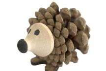 Timber-Treasures pine cone hedgehog / Each Timber-Treasures pine cone hedgehog is hand crafted from a pine cone, laser cut wooden feet and a hand turned face. Showing the quirky and timid nature of the animal, the rustic qualities of the pine cone bring a natural element and a remembrance of the hedgehog's woodland home. 8 x 5 x 4 cm* *handmade disclaimer
