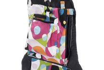 k'Boodle Diaper Bag Products / k'Boodle's systematically organizes all your must have items so you know exactly where to find them every time.  Always know where your wallet and keys are, easily grab wipes and diapers from designated pockets, use the loops to organize teethers, pacifiers, bottles, and more.