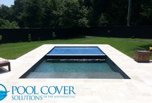 Backyard Pools / A pool is a wonderful way to spend time with your loved ones.  Spend less time worrying about maintenance and accidents and more time making memories.  An automatic pool cover is the answer.  It saves time and saves lives.  This gorgeous backyard oasis has beautiful travertine decking and an undertrack recessed cover.