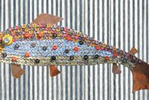 Fish Mosaics by artist John T. Unger / Fish mosaics by artist John T. Unger. The mosaics are made of tile or with recycled bottlecaps.