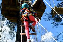 Lovetar - vihreä rata / Lovetar oli muinaissuomalaisille susien suojelija ja kantaäiti. Lovetar-rata rakennettiin aikuisten helpoksi radaksi, jolla korkeuksia hiukan kammoksuvat pääsevät kokeilemaan seikkailemista. A ropeladder leads up to four meters height where even the little timid ones can challenge their sensitivity to heights.