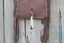 Leather handbags / We have a line of leather handbags. We design all our leather bags . They are all handmade, hand stitched with attention to detail.