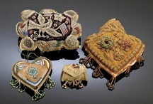 Iroquois Whimsies / Once discarded as collectible, Iroquois Whimsies are tourist trade items created in the late 18th century by the Mohawks near Montreal and the Tuscarora of Niagara Falls. Items include pincushions, purses, picture frames, needle cases  and other ornate wall hangings exhibiting the raised beading technique. / by Double D Ranch