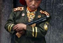 Kids in war, poverty and suffering / by Soraya Rietkerk