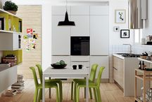 A trendy comniation of the kitchen and dining room