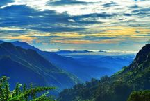 Ella,Sri Lanka. / Ella is a small town in the Badulla District of Uva Province, Sri Lanka. It is app; 200 km (120 mts) east of Colombo and is situated at an elevation of 1,041 metres (3,415 ft) above the sea level. The area has a rich bio-diversity dense with numerous varieties of flora and fauna. Ella is surrounded by hills covered with cloud forests and tea plantations. The town has a cooler climate than its surroundings, due to its elevation. The Ella Gap allows views across the Southern plains of Sri Lanka.
