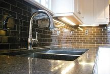 Kitchen Tile Installations / Natural stone subway tile installed by Mario