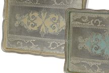 Tizo Trays / Italian made Tizo trays are elegant all unto themselves. These lovely hand-painted wooden trays can be displayed as works of art or used to display your favoirte collection anywhere in the home.