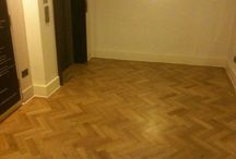"""Damaged Parquet Floor Temporarily Replaced / Client: Commercial building in Victoria – Central London. Brief: A parquet floor was damaged and partially replaced & restored. The customer: """"I was checking on various things the other day including the lift lobby floor – and I would like to record my appreciation for the superb job which you and your team did in that area – the finish looks great !! Very many thanks."""" Michael Managing Director."""
