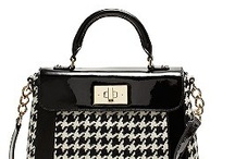 It's where all my money goes...handbag heaven / by Falon Kerby