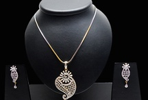 Pendant Set / A wide range of pendants with gems like emeralds, crystals and amethysts set on alloy, precious metal, glass and other base materials.